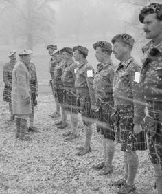 +~+~ Vintage Photograph ~+~+  The King inspects officers of 5th Battalion Seaforth Highlanders during a snow storm at Gorhambury Park in Hertfordshire, 29 February 1944.  And that's why kilts are worn by real men!