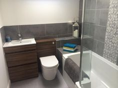 This walnut bathroom furniture looks great against the grey tiles by Judith from Buckie #VPShareYourStyle