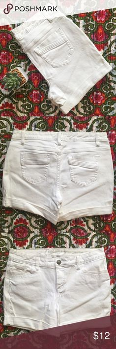White Jean Shorts Mid/High Waisted Great pair of shorts. I love the button detailing. 10 inch front rise and 5 inch inseam. There is a slight discoloration from wear on the inside of the waistband-- otherwise no visible stains or tears on the outside of the jeans! Sonoma Shorts Jean Shorts
