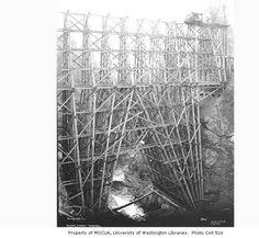 High trestle under construction, probably over Oxbow Canyon of the Wynoochee River, Simpson Logging Company, n.d. :: Kinsey Brothers Photographs of the Lumber Industry, 1890-1945