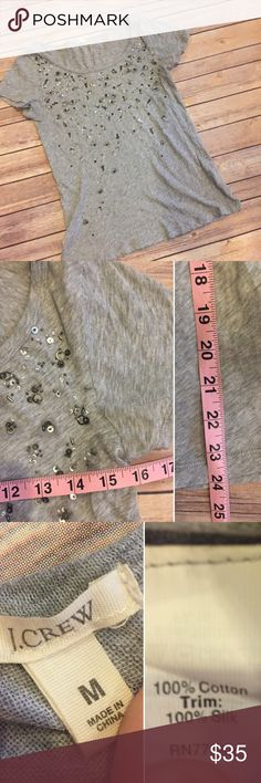 J. Crew Sequin detail tee Super cute basic tee gets a dressy flare with pretty Sequin detail on this J. Crew classic piece. Dress up or down. Measurements and fabric in photos. EUC/Like new. No trades J. Crew Tops Tees - Short Sleeve