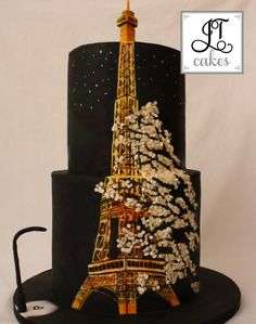 Eiffel Tower Cake Eiffel Tower Cake This was an inspiration photo sent by a super cake friend. Original photo is the bottom one. Spent hours painting the Eiffel. Leaves are sequins. Hope you like it  JT Cakes https://www.facebook.com/JTcakesmalta