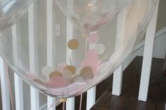 Swell Parties: {The Sweetest Girl Sprinkle for a Swell Addition} A sprinkle baby shower for our new baby girl. Floral arrangements, sparkles, pink and gold accents. Confetti balloons from Etsy.