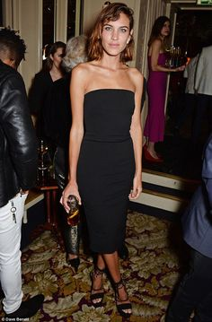 Natural beauty:The striking model looked stunning in a simple yet elegant black strapless...