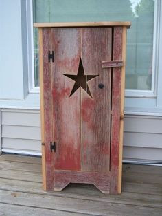 Perfect size cabinet to add that rustic touch to any room in the house. Made out of red barn board with 2 shelves inside and star cut in the door. Primitive Wood Crafts, Primitive Stars, Primitive Homes, Primitive Furniture, Country Furniture, Country Primitive, Primitive Cabinets, Primitive Bedding, Primitive Shelves