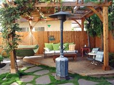 Relaxing lounge area in one corner of backyard with pergola and patio heater