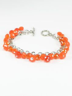 Bracelet 1547 - Looking for a pop of colour? Interested in colour blocking? This modern design antique silver bracelet features bright mandarin orange glass rondelles that will add a little fun to any outfit.