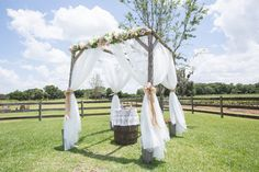 Plant City Outdoor Rustic Wedding Ceremony Altar with Pink and Purple Flowers | Plant City Wedding Venue Wishing Well Barn
