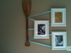 Kind of like hanging the pictures on a curtain rod, but on boat paddles instead!