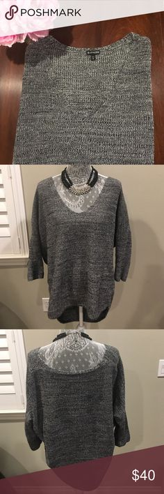 Gray High-Low Sweater Top This gray high-low sweater top is perfect for a fall or winter day! It is a size medium with 3/4 sleeves and 100% cotton. It is flowy and comfortable and still in good condition. Necklace not for sale. Let me know if you're interested. Express Sweaters V-Necks
