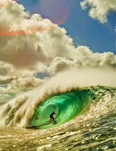 Surfing in the ocean with big waves.