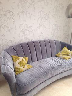 Grey sofa against grey wallpaper