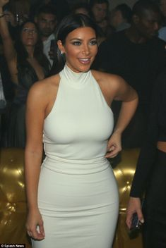 Form-fitting: Kim showed off her famous curves in a white dress for the night