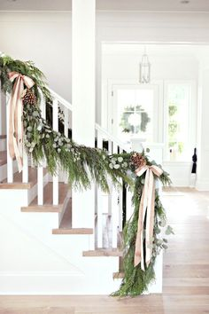 The Shopper's Guide to Super-Chic Holiday Decor - winter decor Merry Little Christmas, Noel Christmas, Winter Christmas, Rustic Christmas, Christmas Garlands, Banister Christmas Decorations, Cheap Christmas, Christmas Staircase Garland, Christmas Greenery