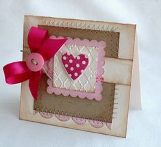 Valentine card with scrapbook material and stamps