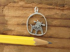 This handmade sterling silver goat necklace is 3/4 of an inch tall. Pretty darn cute! Image is on both sides. Items are shipped without a receipt in a gift box. If youd like to include a gift message, please let me know. I ship Priority Mail for domestic orders and First Class for international orders. If you need expedited shipping, please convo me. See my policies for more information on shipping: http://www.etsy.com/shop/marmar/policy?ref=shopinfo_policie...