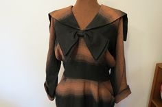 Check out this item in my Etsy shop https://www.etsy.com/listing/471571514/black-and-orange-striped-vintage-1940s