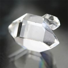 This AAA herkimer diamond has a large double terminated quartz crystal with excellent clarity, beautiful natural facets, and a small twin crystal attached to one side! The rare gemstone measures 14.3 x 9.2 x 8 mm, and weighs 6 carats. This one of a kind stone would make a great meditation / energy healing crystal, or a metalwork / wirewrap jewelry centerpiece. Herkimer diamonds are found throughout the world, but are named after the double-terminated quartz crystals discovered in a...
