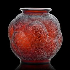 "Lot 1000: LALIQUE Estimate: $10,000 - $15,000  Rare ""Tortues"" vase, France, des. 1926 M p. 432, no. 966 Amber glass with white patina Molded R. LALIQUE 10 1/2"" x 9 1/2"" Provenance: The Solana Collection"