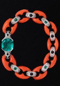 http://rubies.work/0842-ruby-pendant/ Circa 1922 Cartier coral, diamond, onyx, and emerald bracelet.♥•♥•♥