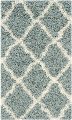 Features:  -Origin: Turkey.  -Collection: Dallas Shag.  Product Type: -Area Rug.  Primary Color: -Ivory and Light Blue.  Material Details: -Power loomed polypropylene.  Product Care: -Vacuum safe. Dim
