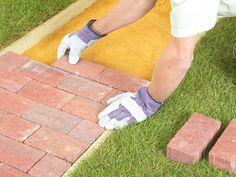 How to Lay a Brick Pathway Create a welcoming entrance to your home by laying a brick or paver walkway.