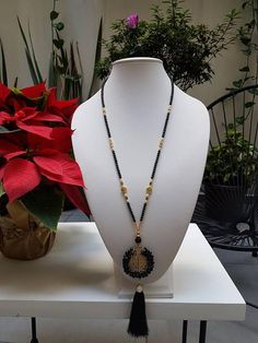 Long necklace of San Benito with Tassel of silk threads ...  Materials: Tibetan Avalorios, St. Benedict Brass pendant, and silk tassel.  Colors: Black & Red Shipments: Worldwide  Shipping to all over the world using emails from Mexico. International shipments may take 15 to 20 working