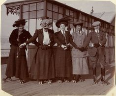 Agatha Christie (in centre) Roller-skating on Torquay pier with the Lucy family. c 1911. 'Roller-skating on the pier was a pastime much in vogue. The surface of the pier was extremely rough and you fell down a good deal, but it was great fun.'
