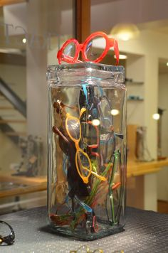 jar of eyeglasses - not as nice as a frame with glasses attached but could work