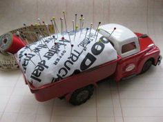 ...childs old truck...turned into a keepsake pincushion!  love it!