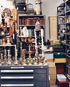 A counter with an assortment of candlesticks in the Martha Stewart prop room.