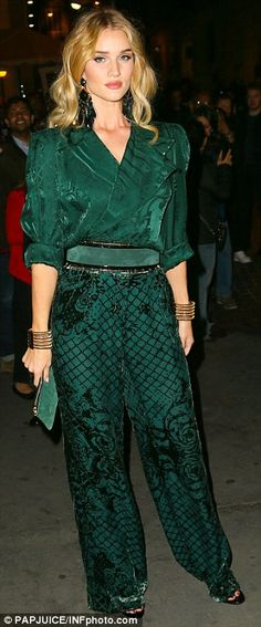 Rosie Huntington-Whiteley stuns in ornate monochrome jumpsuit as she attends Balmain X H&M launch. Has a 80s retro look with the shoulder pads but I love the color.
