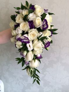 Brides tear drop trailing bouquet created by Lily White florist