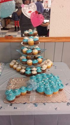 Rattle Baby Shower Cupcake Cake! Used 24 cupcakes.