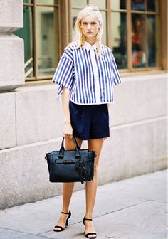 A boxy top might not seem like a universally flattering piece, but paired with a well-fitting miniskirt and cute strappy sandals, it's just right.