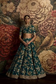 Sangeet Lehengas - Fully Embroidered Teal Lehenga | WedMeGood | Crop Top and Lehenga by Sabyasachi , Teal Colored with Gold All Over Embroidery #wedmegood #indianwedding #indianbride #lehenga #bridal #gold #teal