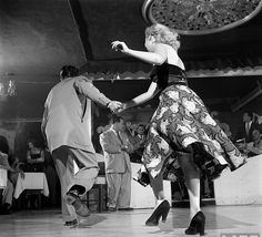 Cutting a stylish rug (love her angel fish print skirt!) on the mambo dance floor, 1951.