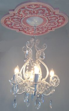 Ceiling Medallion by Marie Ricci with 4 arm white chandelier. Perfect for a big girl room or sweet shabby chic nursery. Set sold for $310 www.mariericci.com