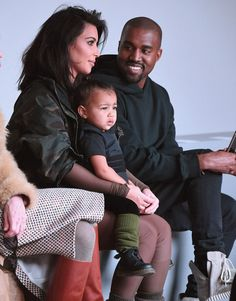 I love this. She actually looks like a real person, and the look Kanye's giving her... So cute.