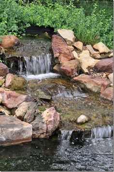 Waterfall created by berkshire watergardens fountains for Koi pond builders greenville sc