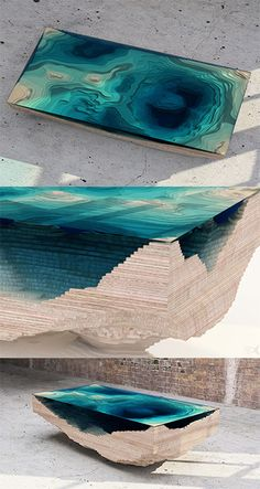 http://duffylondon.com/product/tables/abyss-table/  Amazing Table! Looks like the depths of an ocean. Made out of wood and glass.