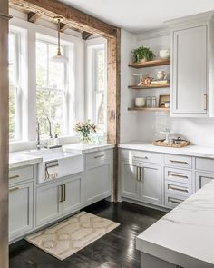 There is some totally rad wood accents in this kitchen! The open shelf inspiration is major! So cool!