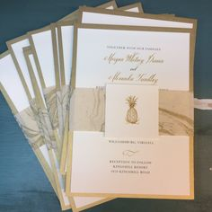 The paper bands on these invitations were cut from handmade paper from Nepal with a gold marbled pattern.