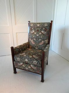 chair upholstered in 'strawberry thief' material - the furniture of the time doesn't quite suit modern taste  - large, comfortable sofas that aren't just modern ones in a william morris fabric are hard to source - the bench seats with cushions of the time don't fit the bill.