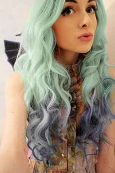 Pretty pastel mint green hair with purple dipped dyed ends... I really like this.