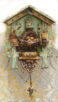 cuckoo clock ASSEMBLAGE Altered ART....  great.. now I need to find a cuckoo clock beautiful romantic grimm and gothic craft piece I could see a fairy or a borrower living in here instead of a cuckoo