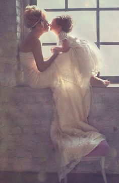 I'm so in love with this picture - bride & flower girl - I want one just like this