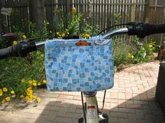 I like this idea!  I definitely need a place to store my stuff other than a pocket when riding my bike... Ready,Set,Go! ~ Ready-to-Roll Bike Pouch « Sew,Mama,Sew! Blog