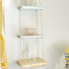Make little shelves from vintage books, twine, and pretty paper.