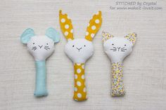Plush rattle baby toy sewing pattern with options for a bunny, cat or mouse.